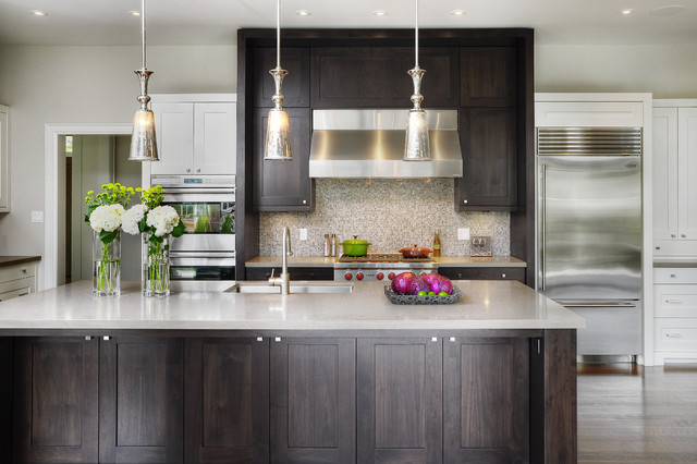 dark shaker kitchen cabinets with white countertops