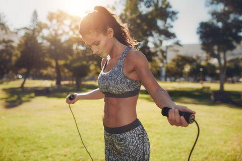 C:\Users\Toshiba\Downloads\fit-young-woman-with-jump-rope-in-a-park-royalty-free-image-1568723463-min.jpg
