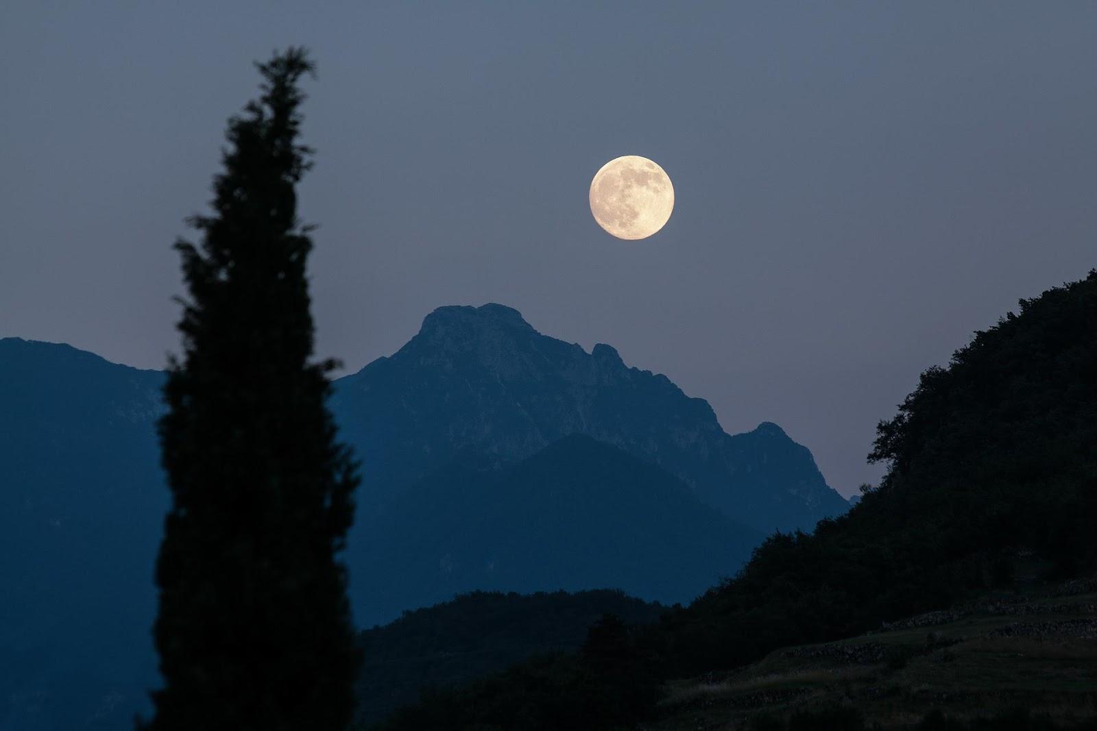 moon against mountain range
