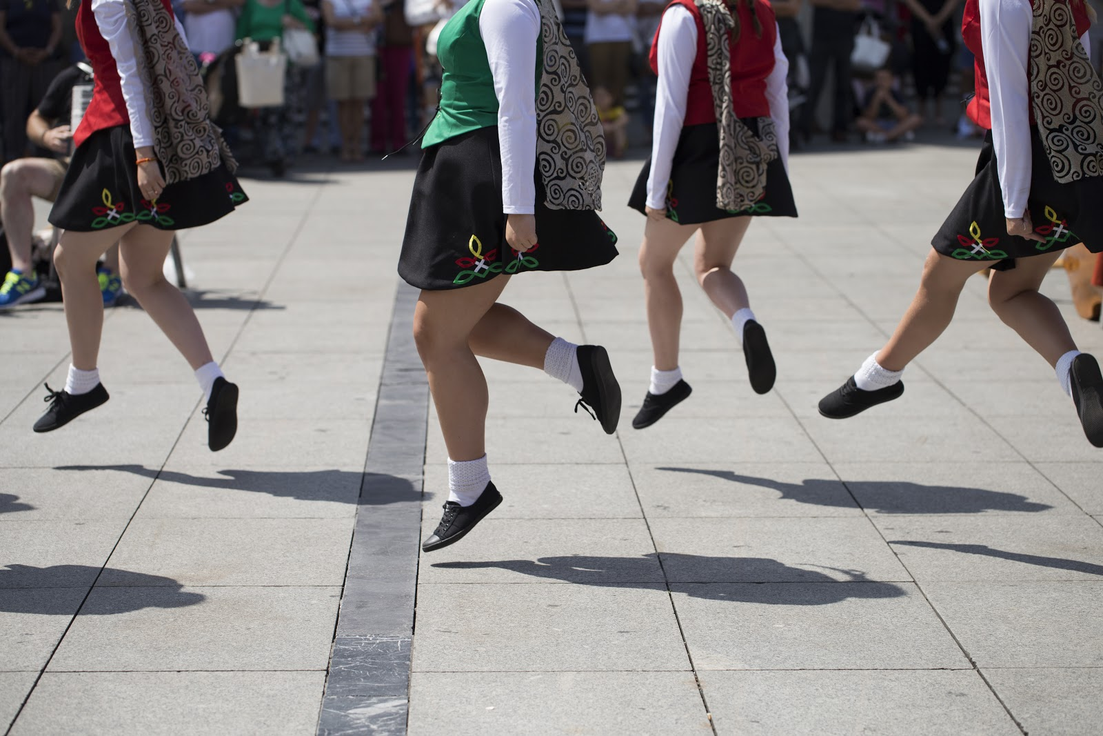 irish dancers dancing in a city square
