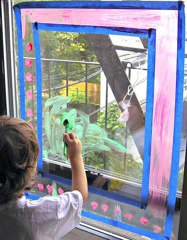 Kid painting on window