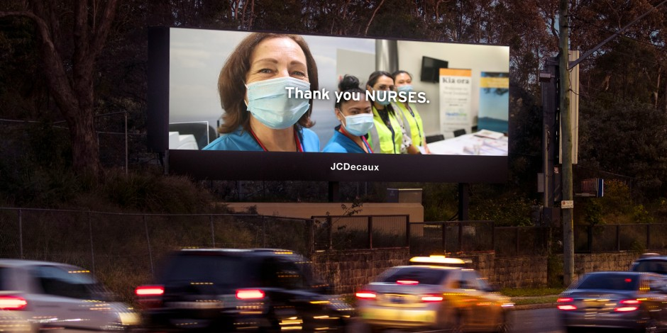 """Billboard by JCDecaux with a picture of several nurses and the message """"Thank you Nurses""""."""
