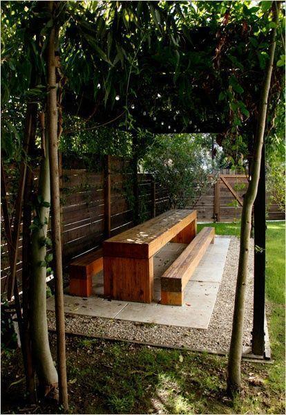 long picnic table under a pergola