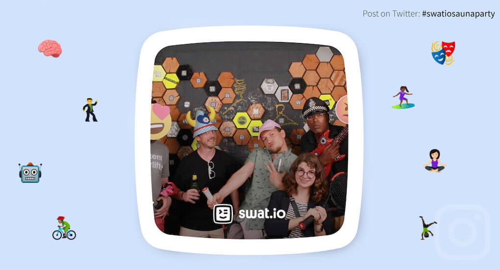 Screenshot of Swat.io's social wall, from a photo booth installed at their employee party. In the image appears a group of people with party props and doing funny poses.