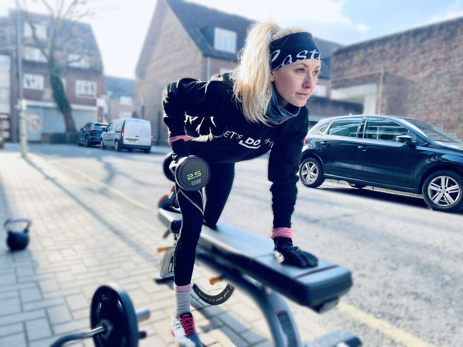 Woman doing a dumbbell row strength exercise for running.