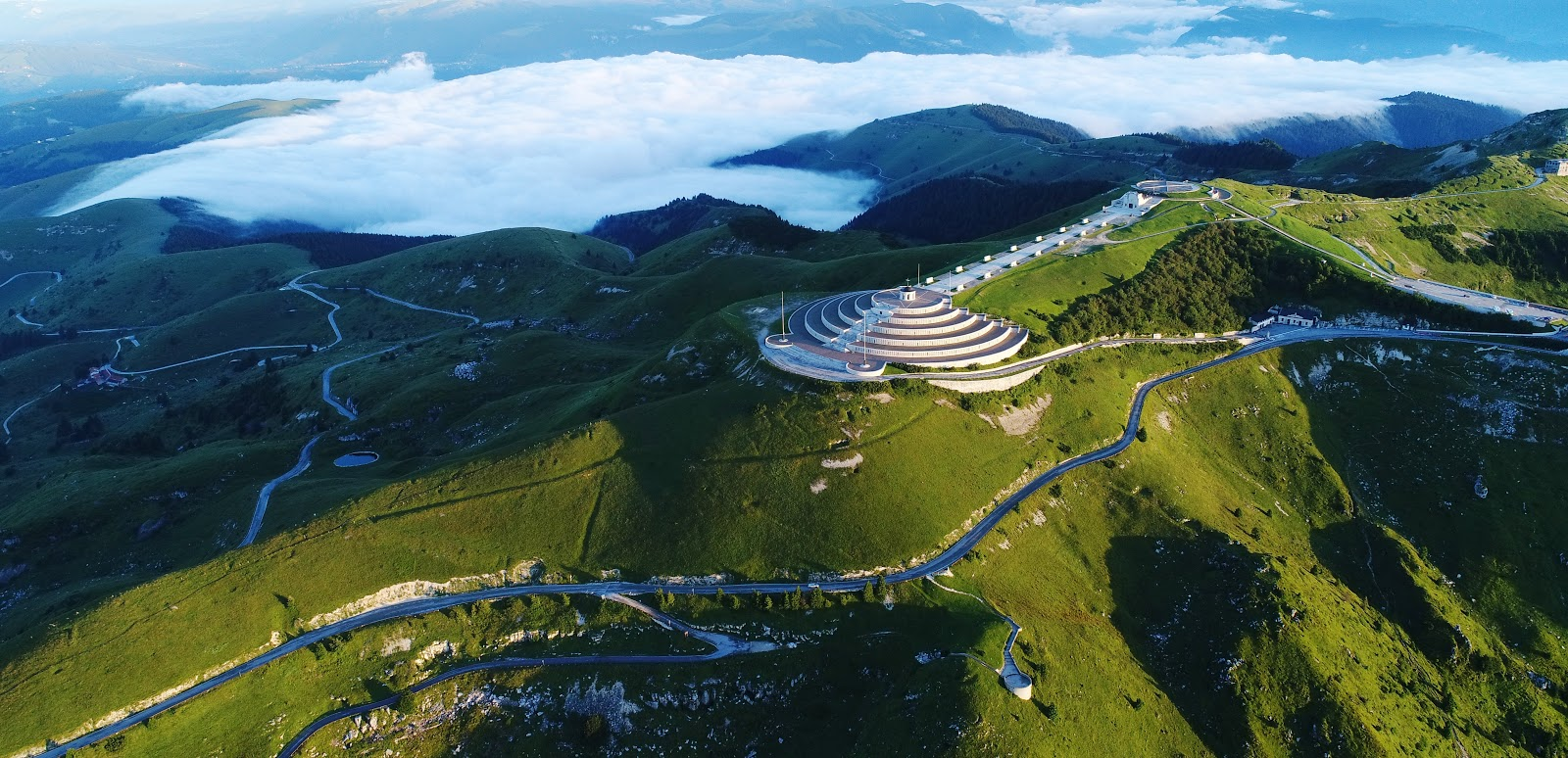 Cycling Monte Grappa from Semonzo - drone aerial photo of Sacrario del Monte Grappa - summit with clouds, Sacrario Militare del Monte Grappa and ossuary