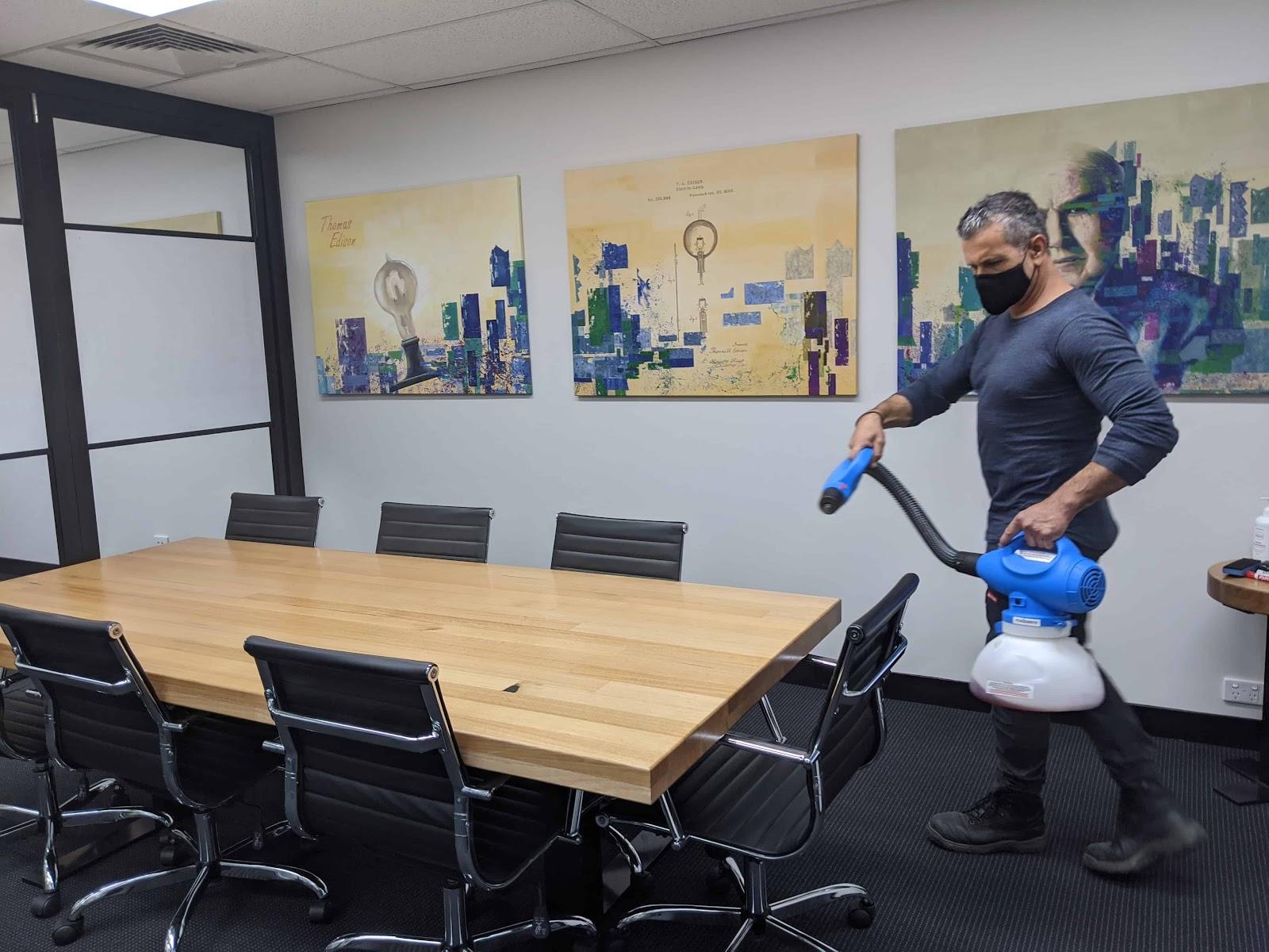 Man Sanitising A Virtual Office
