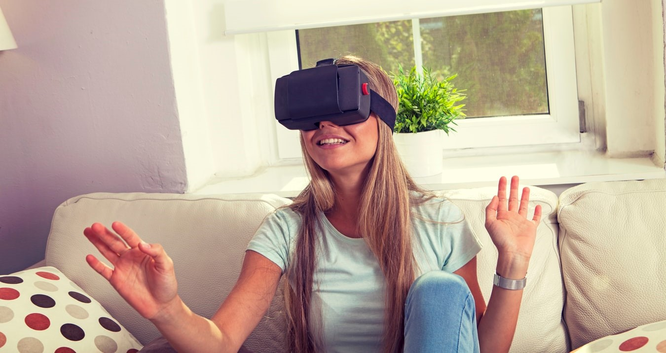This girl wearing a VR headset demonstrates that virtual reality is a very popular gaming choice these days