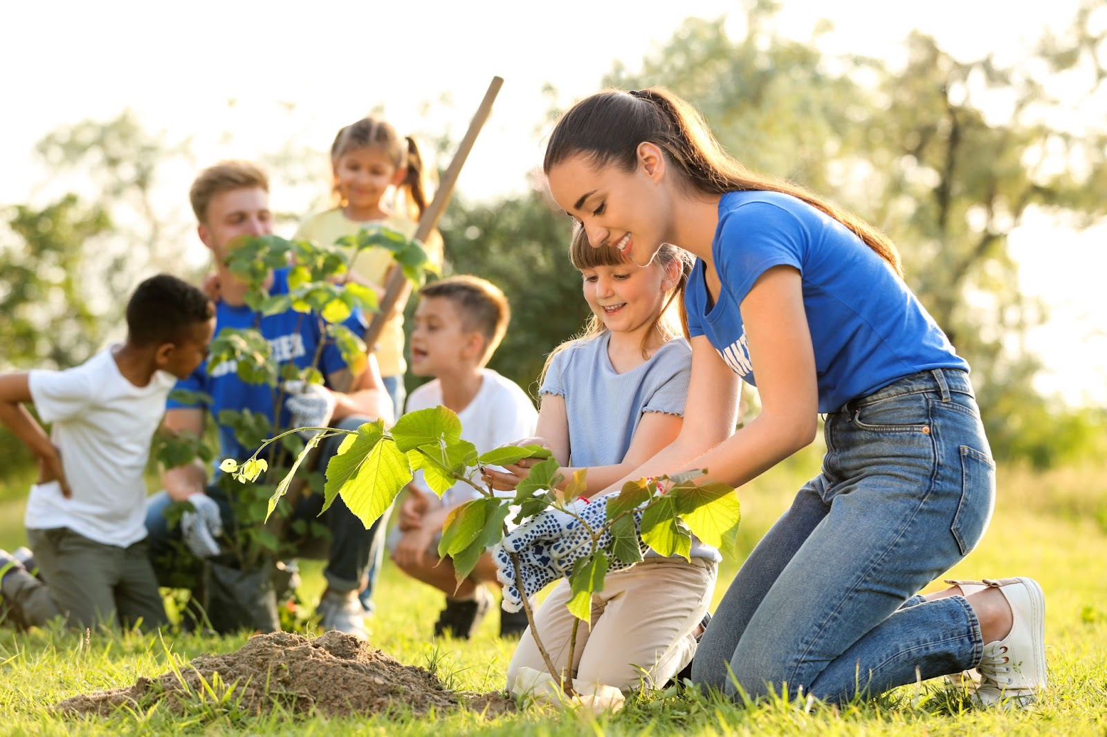 Image of children and young adults participating in community gardening.