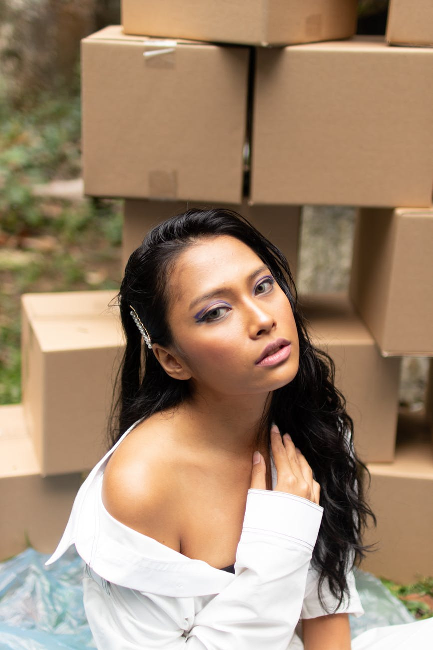 a woman sitted in front of box packages