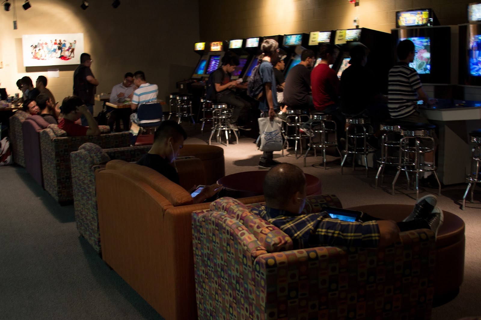 Students lounge around and play arcade games in the Games Room