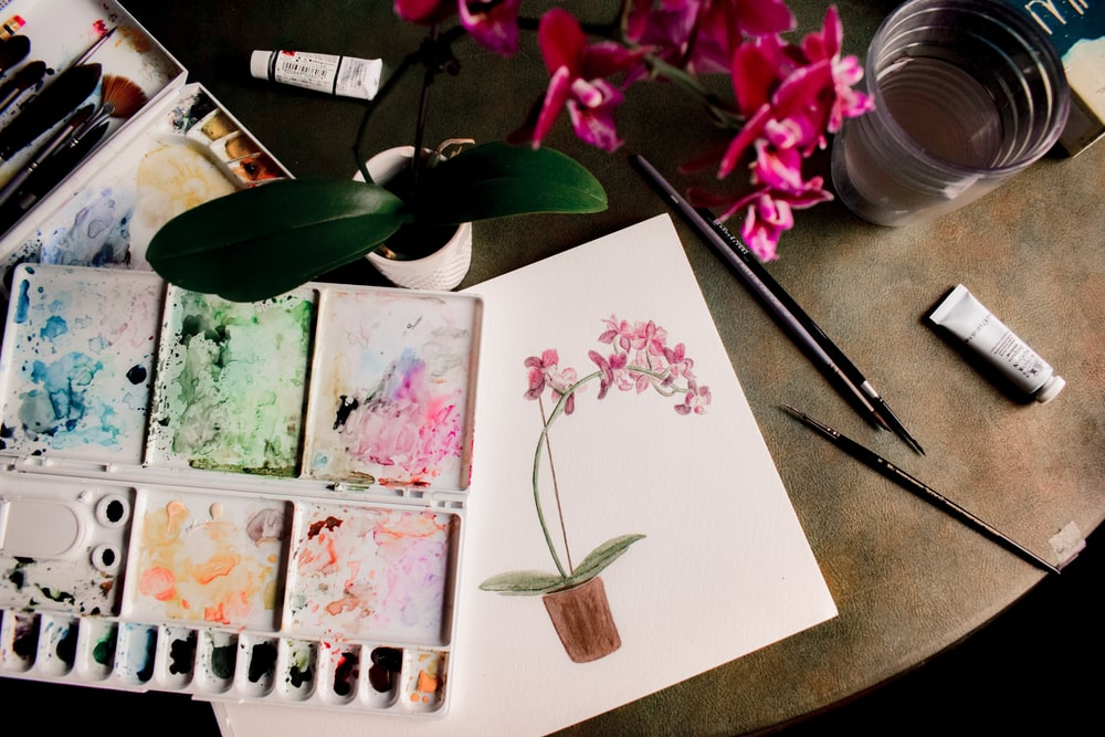 white pink and green floral painting