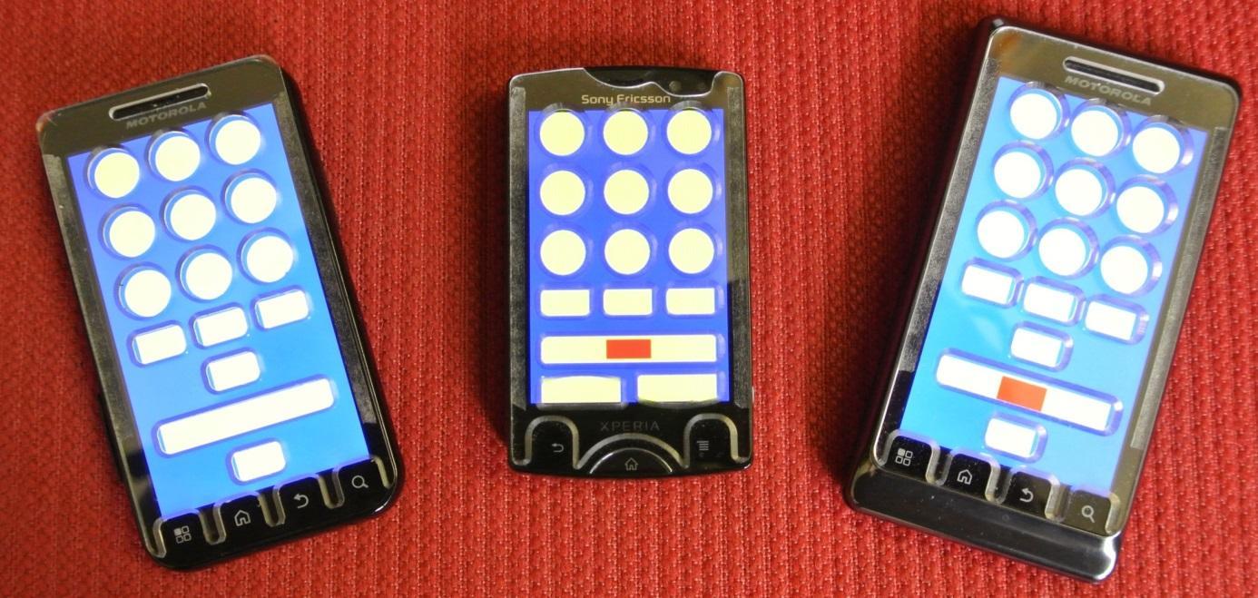 Régi Androidos telefonok ragasztott Braille maszkokkal.