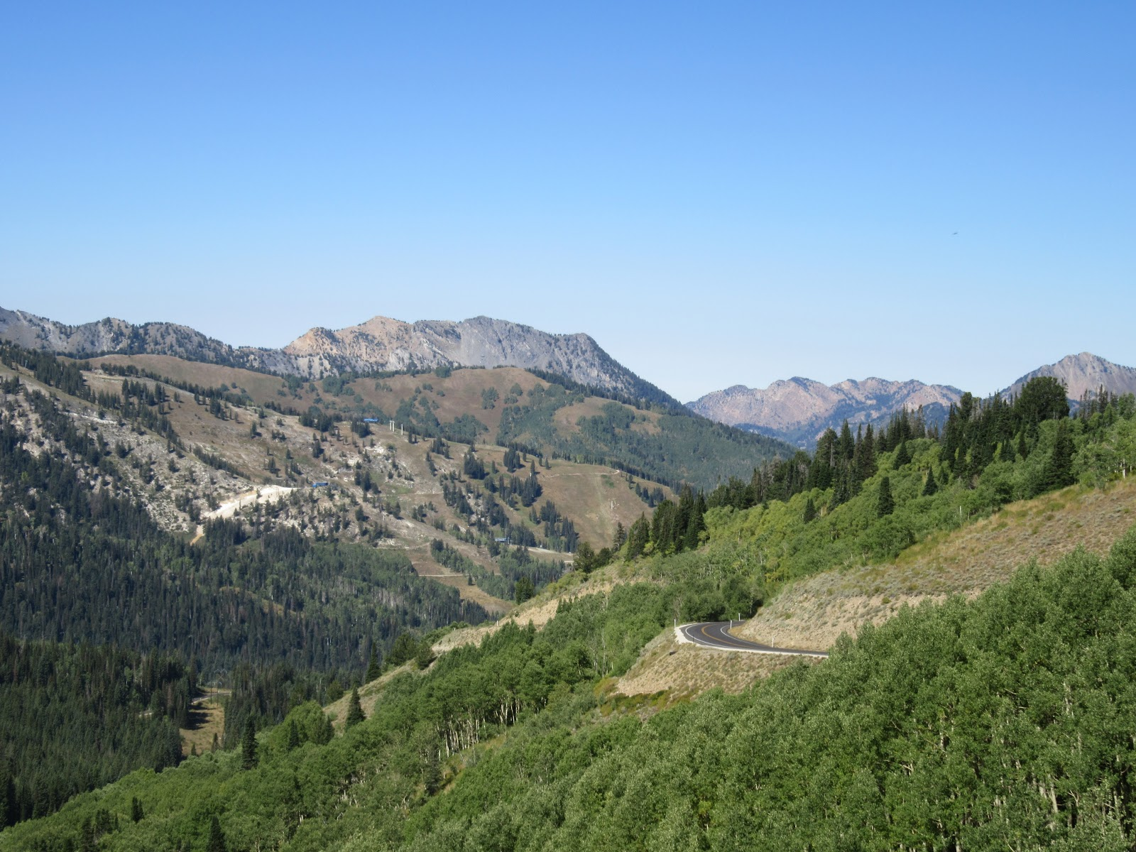 View down on roadway and mountains on Big Cottonwood Canyon climb by bike from Guardsman Pass.