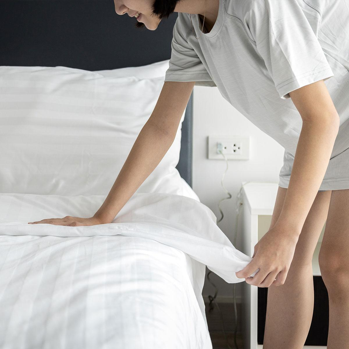 A picture containing person, indoor, bed, whiteDescription automatically generated