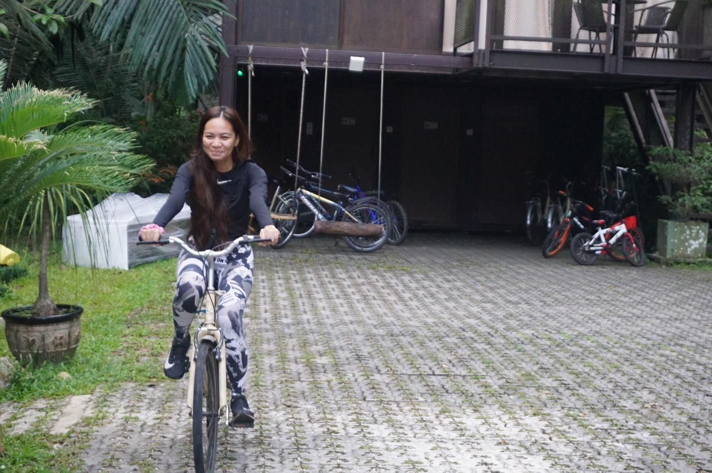 A person riding a bikeDescription automatically generated with medium confidence