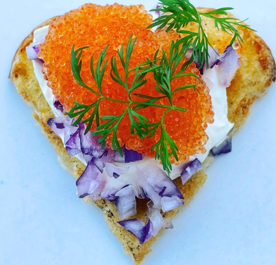 heart shaped bread with orange fish eggs