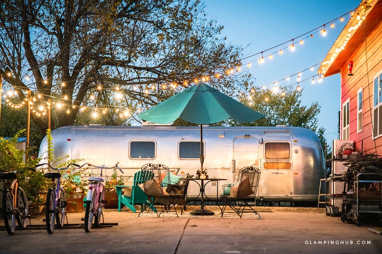 Quirky 1972 Vintage Airstream Rental with a Fireplace Just Outside of Dallas, Texas - Glamping Hub
