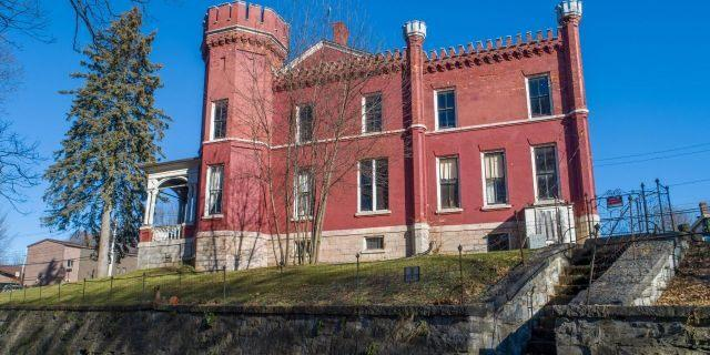 The brick home encompasses about 7,000 square feet across three stories. (Michael DeRosa / Michael DeRosa Exchange, LLC)