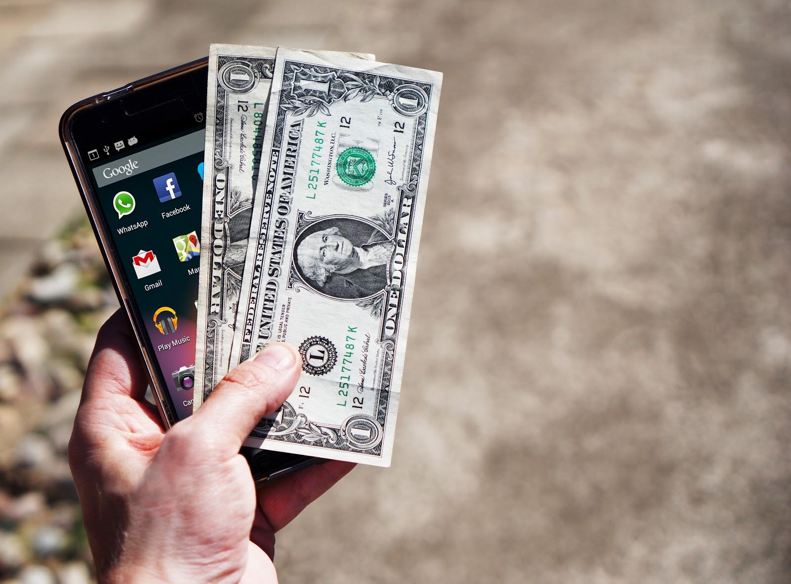 mobile-phone-money-banknotes-us-dollars-163069-2.jpeg