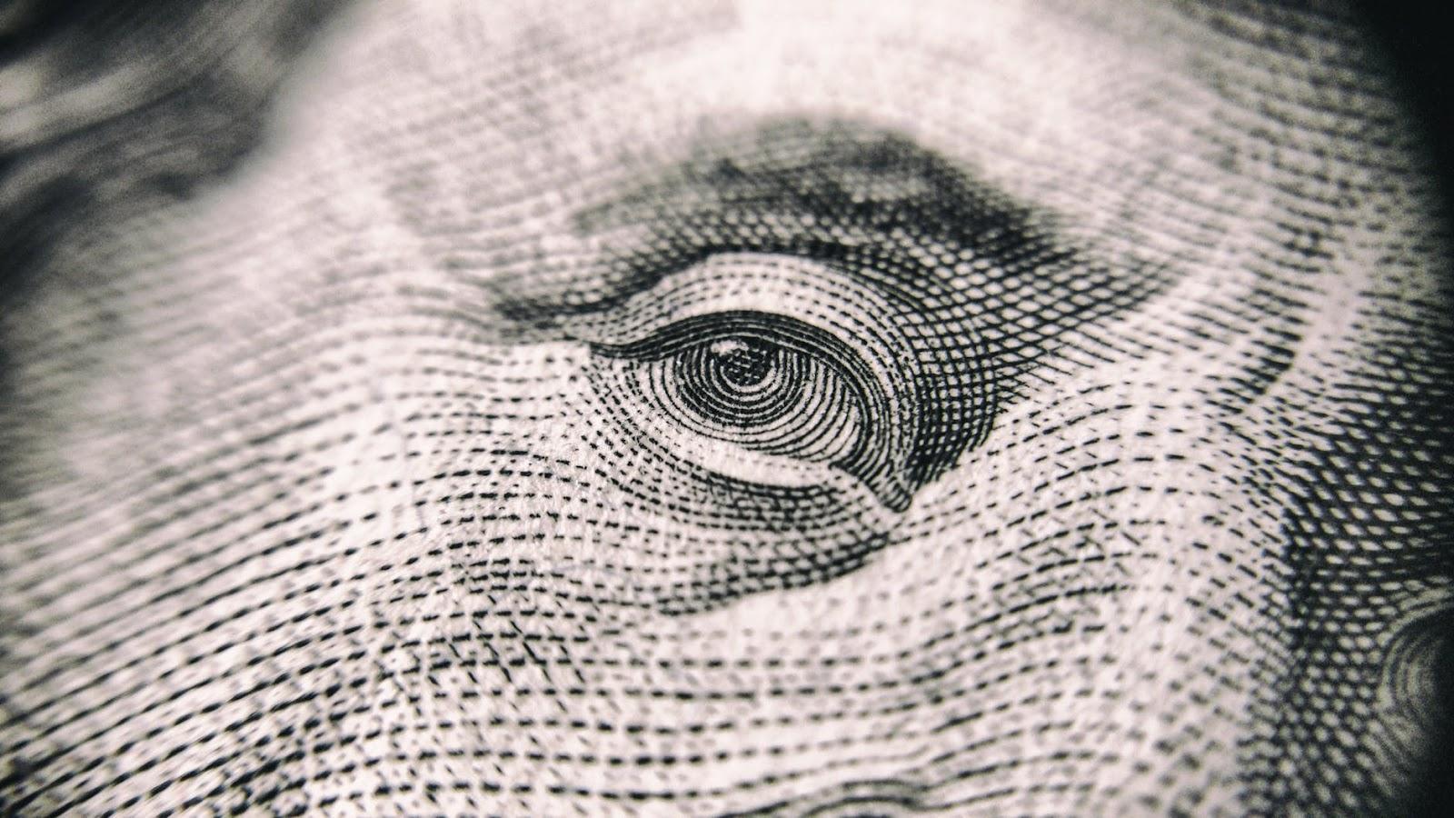 full-frame-shot-of-eye on dollar bill