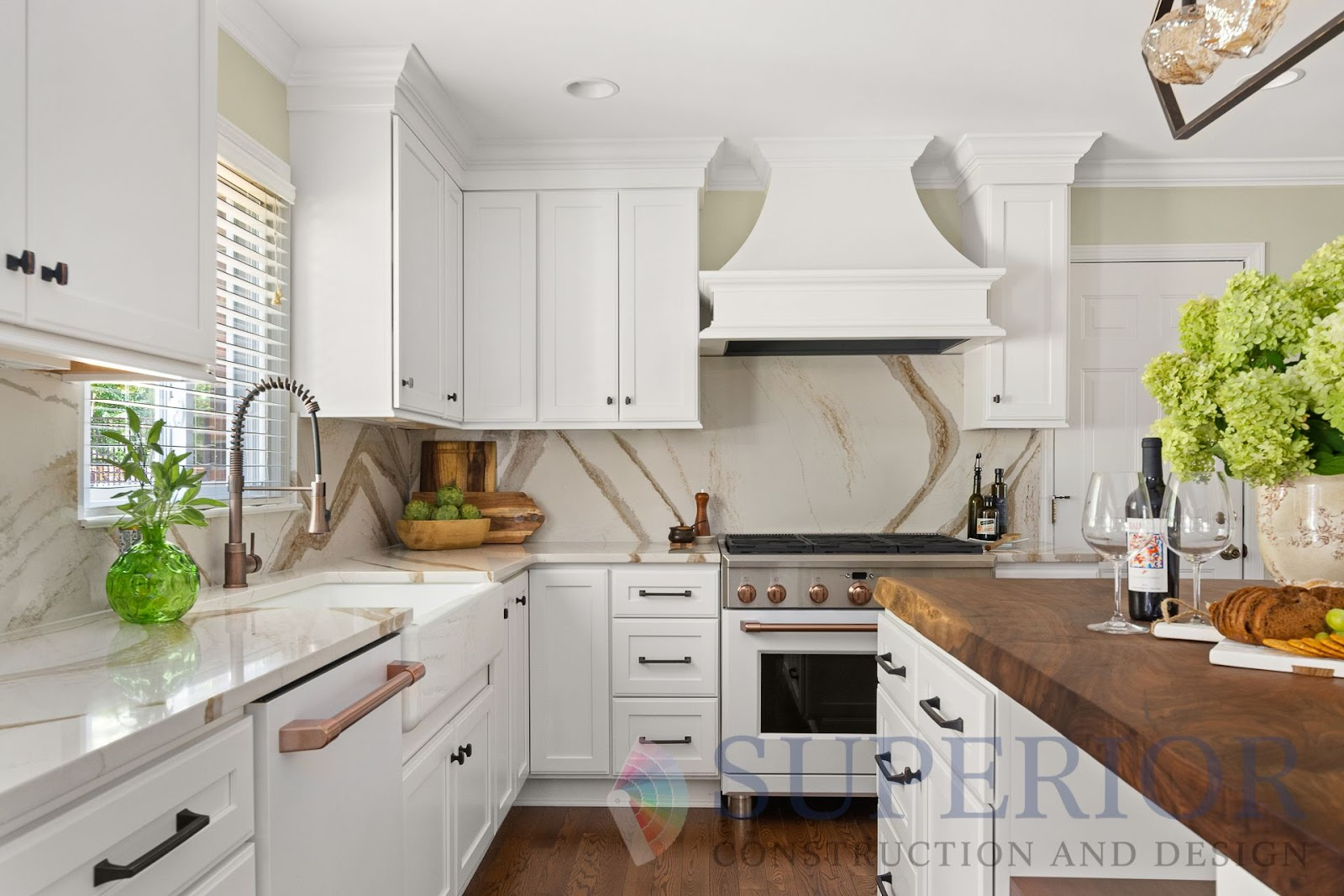 superior-construction-lebanon-tn-designer-showrooms-white-kitchen-with-natural-island-countertop