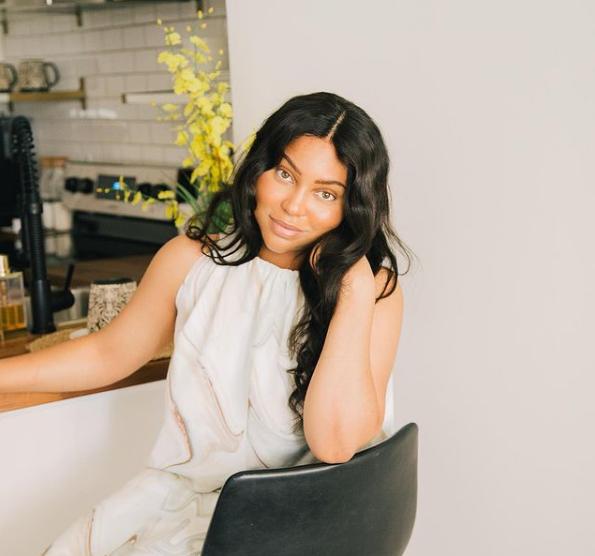 Kiersten H sitting at the kitchen bar | Black Influencers Featured on Afluencer