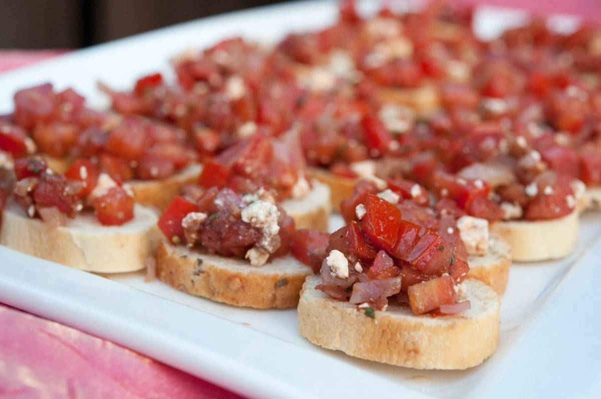 Crostini with tomato chutney, crumbled gorgonzola, caramelized onions, and honey on top. A perfect appetizer!