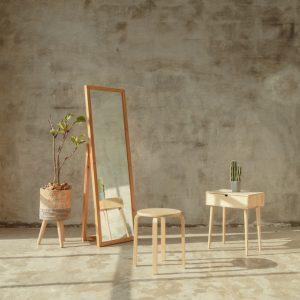 A floor mirror in a minimalist room. The usage of floor mirrors in interior design is making a comeback.