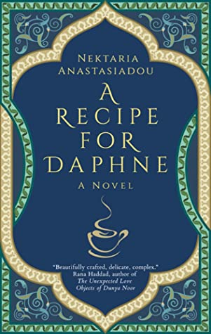 The cover is an intricate design resembling the art style of a mandala. The design acts as a border for the cover, so it alternates between seafoam green and white-gold lines with green, gold, and royal blue swirling patterns in the top and bottom corners of the cover. The center of the cover is a royal blue background. The author's name and book title are in the center. An outline of a coffee cup with steam coming out the top is under the book title in the center of the image. The author's name is at the top center and reads Nektaria Anastasiadou. The book title reads A Recipe for Daphne: A Novel.