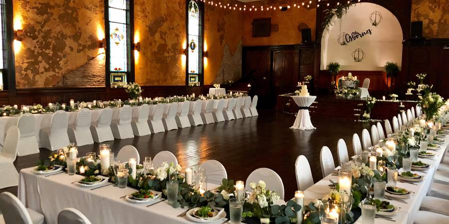small wedding venue space with dinner plates ready for reception