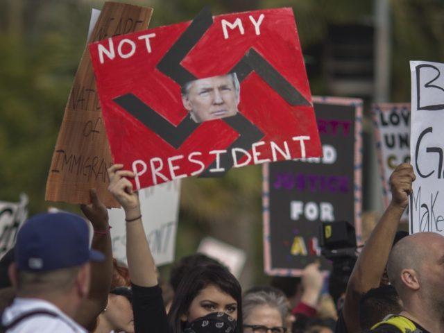 Trump swastika (David McNew / Getty)