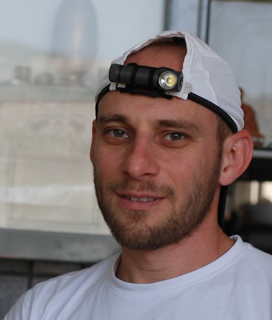 Me wearing ZebraLight H52w on a Velcro closure of my running cap