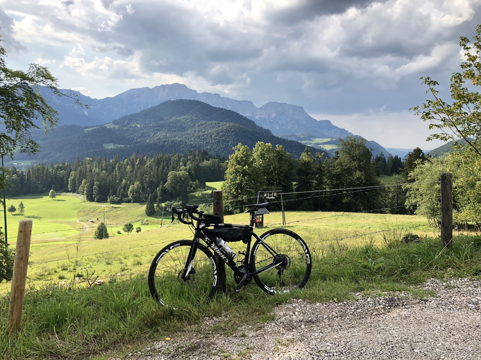 Climbing Kehlsteinhaus - Eagles Nest by bike - bicycle against fence with mountains in background