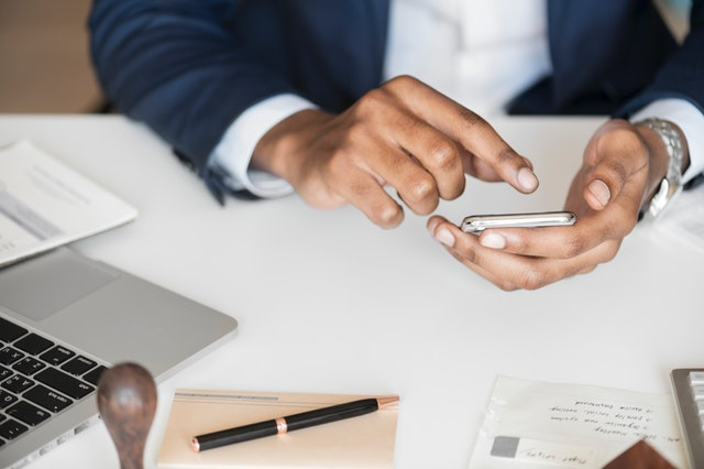 employee playing with cellphone while working distractions in business