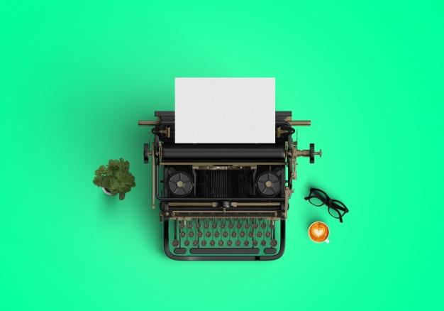 Typewriter on green background Free Photo