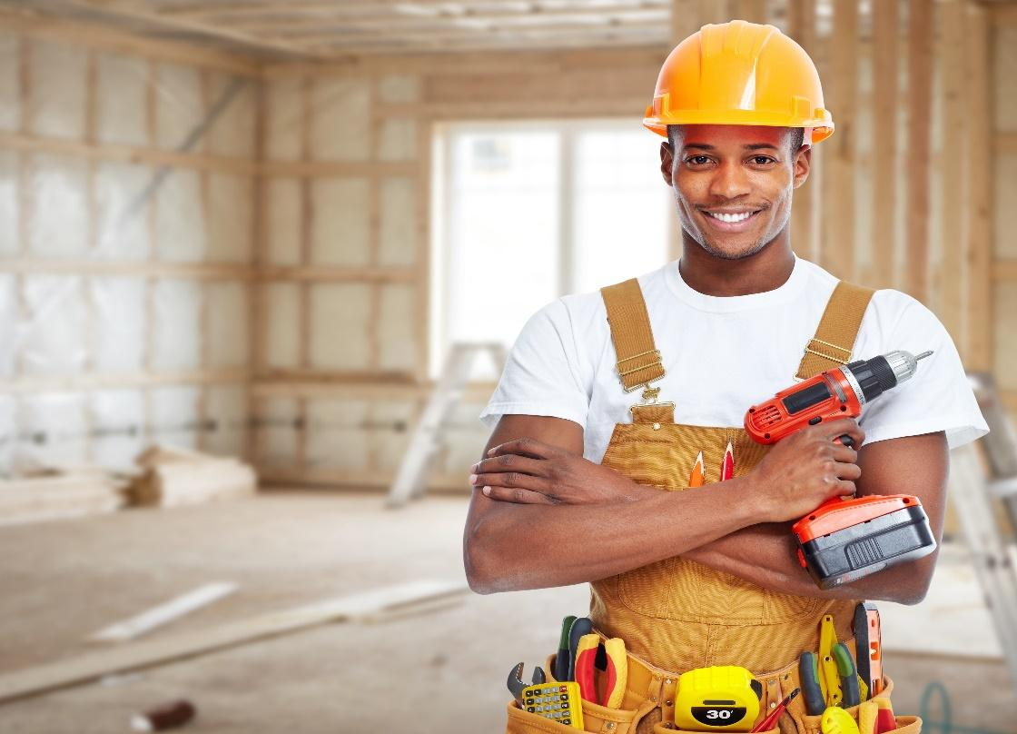 Construction worker in new house. Renovation background. » Hopping In!