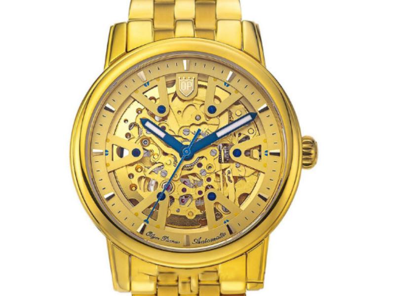 Cận cảnh bộ máy cơ của đồng hồ Olym Pianus qua mặt đồng hồ được thiết kế lộ máy