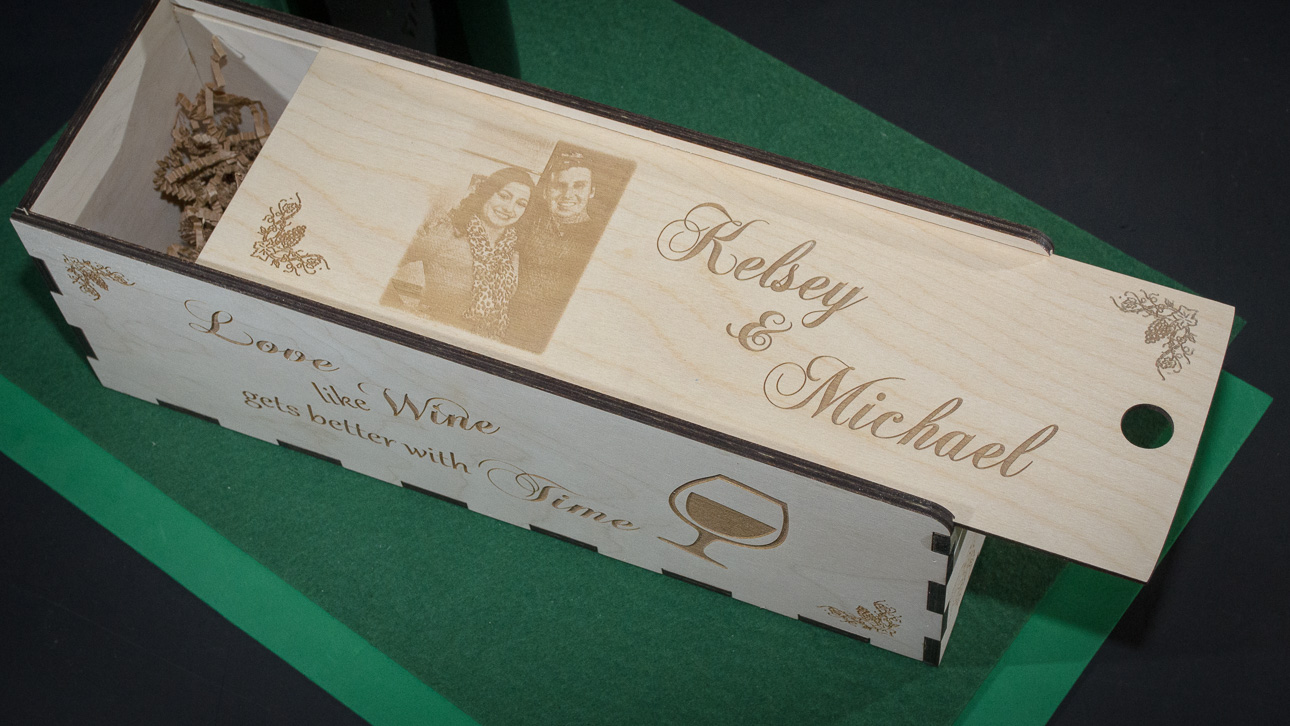 """I build custom wine or champagne presentation gift boxes, laser engraved with names, dates, LOGOS, poems, verses and PHOTOS. Your celebration gift will be noticed and appreciated for years to come as these wood boxes are displayed for all to see. They are never re-gifted! Your thoughtfulness and consideration will be received with """"wow, nice gift"""".  All the pieces of the gift box are laser cut out of baltic birch wood, then both surfaces are hand sanded, then glued and pinned together to make a unique personalized gift for the occasion.  I can laser names, dates, photos, logos and other graphics to make your gift the most creative and one-of-a-kind yet."""