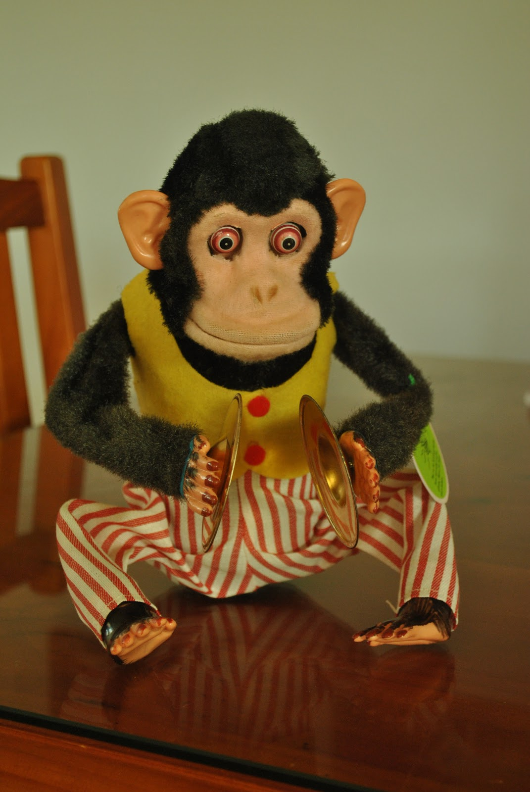 Cymbal-banging monkey toy