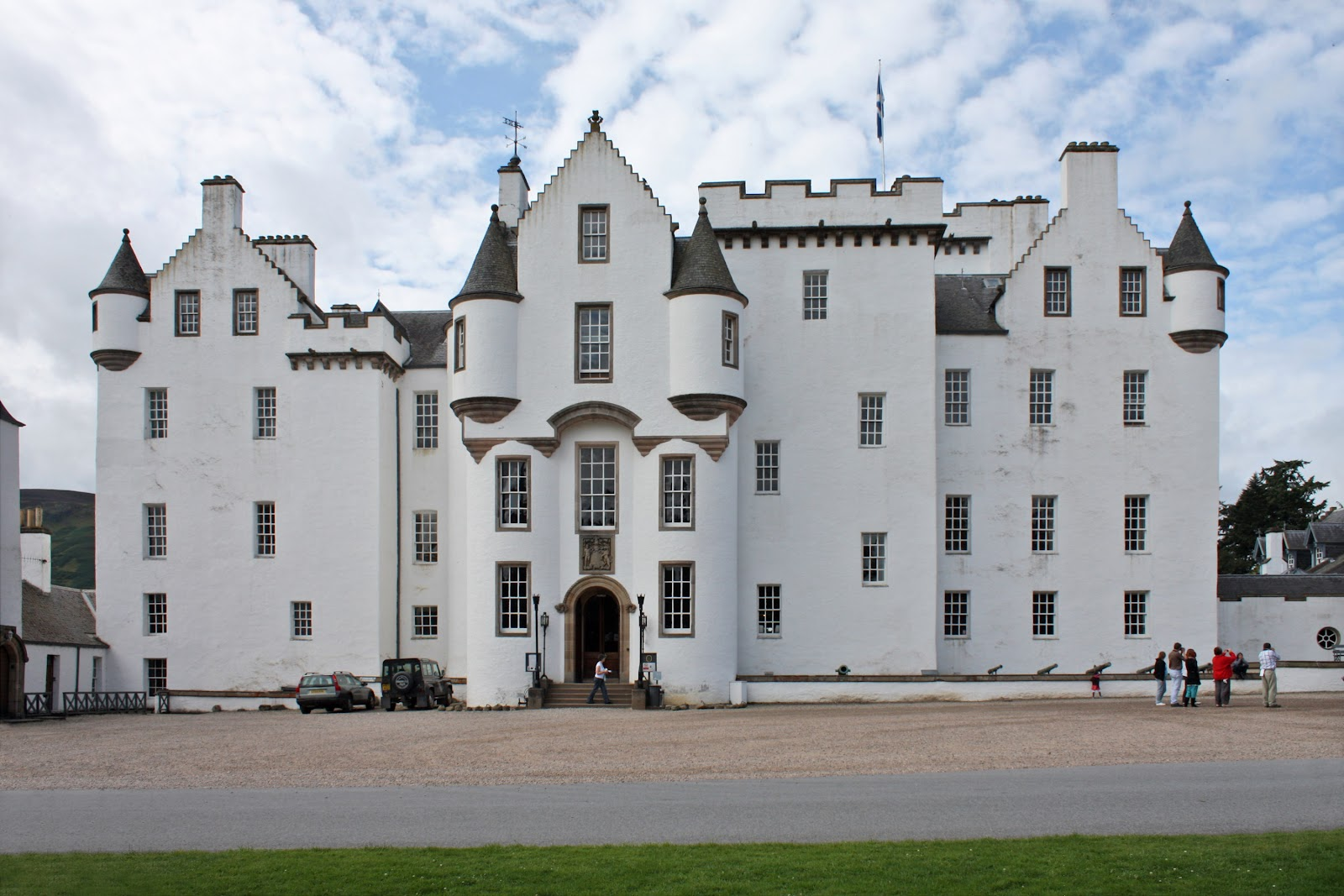 blair castle frontal view, symmetrical photo from across the castle shows its white walls, windows. cloudy day in great britain.