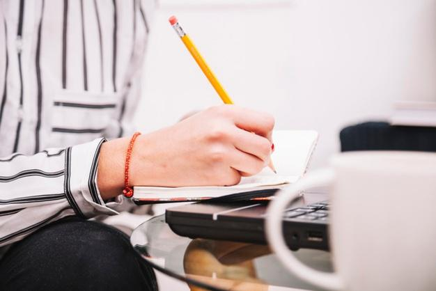 teenager making notes