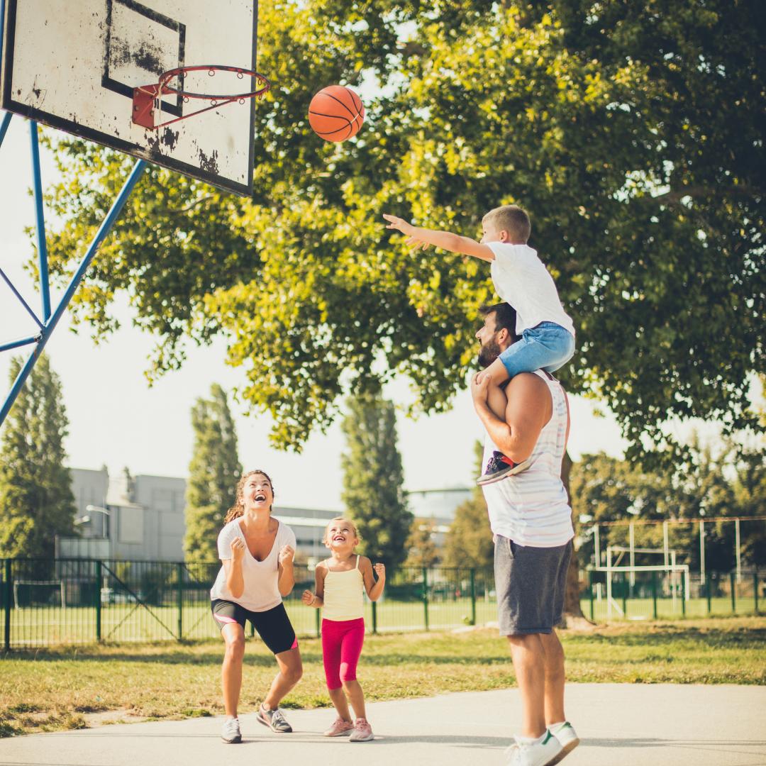 summer fun playing family basketball