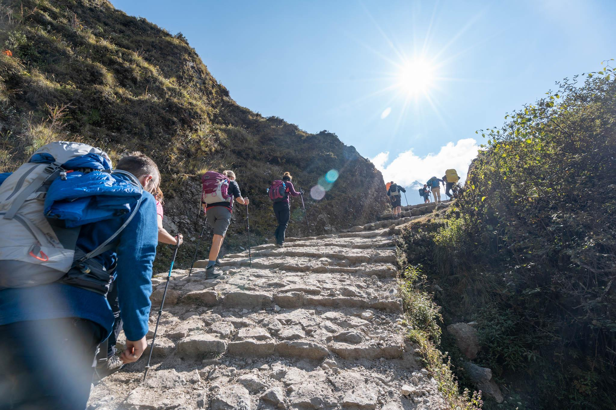 A group of trekkers climbing up a trail on the Everest Base Camp journey