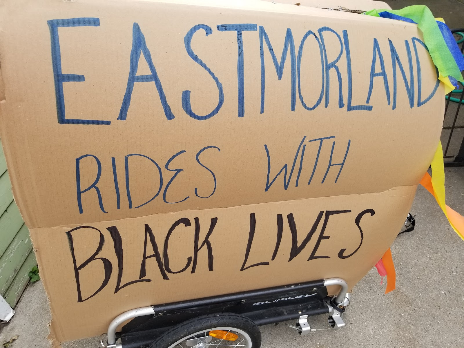 eastmorland rides with black lives sign