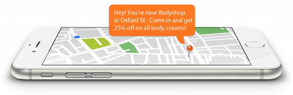"""An iphone with talking baloon says """"Hey! You're near Bodyshop in Oxford St. Come in and get 25% off on all body creams."""""""