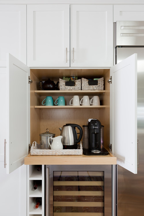 white shaker cabinets with pull out coffee station and wine bar