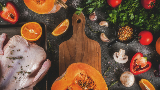 a turkey being prepared for Thanksgiving with citrus