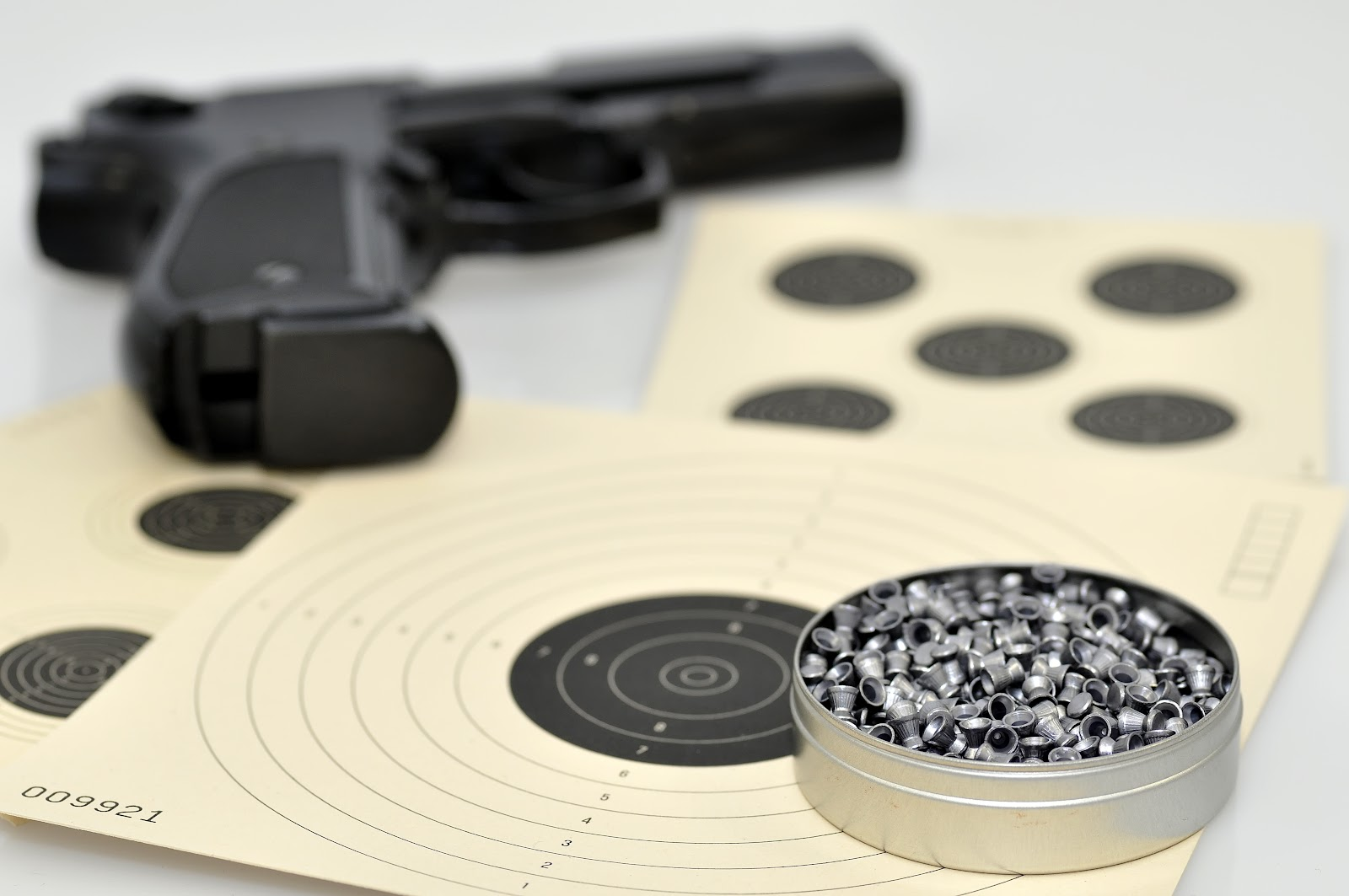 paper targets and a pistol