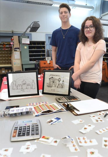 Clayton Sibert (left) and Maddie Phillips created commemorative postmark designs for Streator's sesquicentennial celebration. Community members voted for their favorite design at the Streator Post Office. Sibert's landmarks-inspired illustration claimed the highest vote tally.